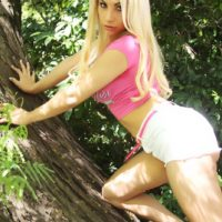 Non nude blonde tranny Angeles Cid posing for glamour shoot outdoors in shorts