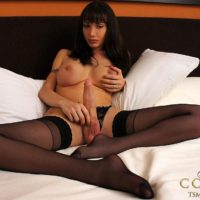 Stocking attired brunette shemale Mariana Cordoba jerking off massive cock