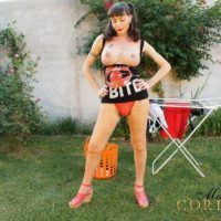 Busty Latina tranny Mariana Cordoba displaying large penis outdoors in back yard