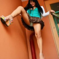 Leggy brunette ladyboy Vitress Tamayo flashing upskirt panties and big boobs outside