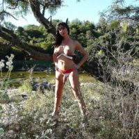 Leggy brunette tranny Mariana Cordoba freeing huge cock from panties in woods