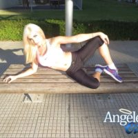 Sporty blonde shemale Angeles Cid freeing sexy ass from spandex pants in public