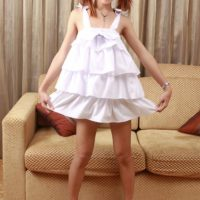 Redhead ladyboy Tus strips naked and jerks off with hair up in pigtails