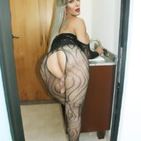 Busty blonde tranny Nelly Ochoa flaunts her big dick in a crotchless bodystocking