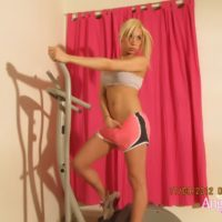 Blonde shemale Angeles Cid freeing big tits and large cock from workout clothes