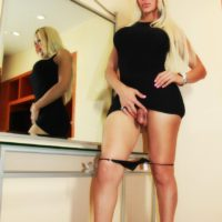 Blonde shemale Azeneth Sabrok freeing hung cock from panties and dress
