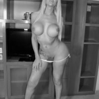 Blonde solo shemale pornstar TS Azeneth flaunting huge tits and big cock