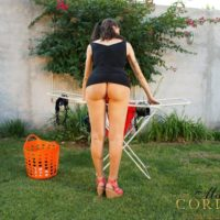 Busty brunette shemale Mariana Cordoba flaunting bare ass and huge cock outdoors