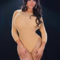Clothed brunette shemale babe Azeneth Sabrok stretching uniform with knockers