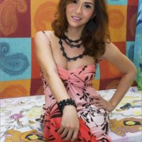 Clothed ladyboy TS Sapphire Young showing off new tattoo and upskirt leg