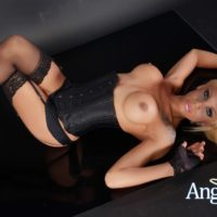 High heel attired tranny Angeles Cid flaunting big tits in lingerie and stockings