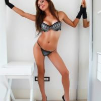 Leggy tranny Alessandra Blonde freeing big tits from lingerie in high heels