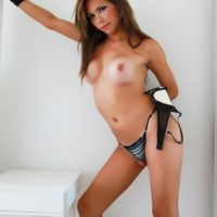 Leggy tranny solo model Alessandra Blonde freeing big tits from lingerie in high heels
