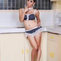 Lingerie attire ladyboy Sapphire Young whipping out shaved cock in kitchen