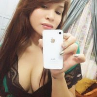 Solo Asian ladyboy Vitress Tamayo taking homemade self shots of big tits