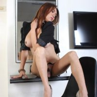 Solo ladyboy pornstar Sapphire Young showing off great legs and upskirt cock