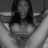 Solo ladyboy Sapphire Young flaunting big tits while exposing shaved cock