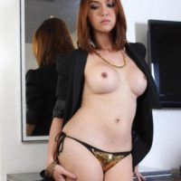 Solo ladyboy Sapphire Young flaunting big tits while masturbating shaved cock