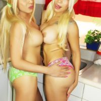 Blonde Mexican shemale Angeles Cid and trans gf whip out big cocks in kitchen