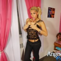 Blonde shemale pornstar Angeles Cid releasing big tits from black lingerie in jeans