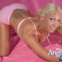 Blonde solo tranny Angeles Cid letting big tits free while modeling in cute socks