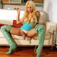 Blonde solo tranny Angeles Cid unleashing hung shecock in stripper boots