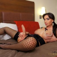 Brunette Latina shemale Mariana Cordoba masturbating hung shecock in mesh stockings