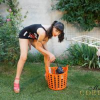 Brunette shemale model Mariana Cordoba demonstrating huge cock in back yard