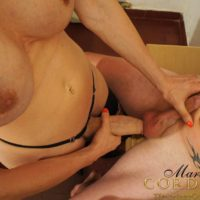 Busty brunette shemale Mariana Cordoba getting blowjob from man in leather hood