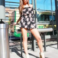 Clothed shemale pornstar Alessandra Blonde showing off sexy legs outdoors in sunglasses