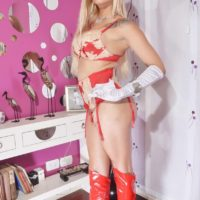 Hot blonde tranny Angeles Cid modeling non nude in knee high boots and gloves