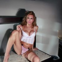 Long legged solo tranny Alessandra Blonde freeing large round tits from lingerie