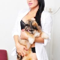 Pretty Asian tranny Vitress Tamayo undressing in a teasing manner for glamour shoot