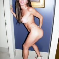 Topless shemale model Alessandra Blonde playing with her big tits in high heels
