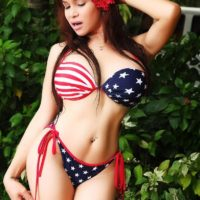 Brunette ladyboy Vitress Tamayo modeling non nude in and out of pool in bikini
