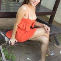 Leggy brunette ladyboy Emmy 2 giving fully clothed blowjob outdoors in back yard