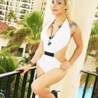Tattooed blonde tranny Angeles Cid posing non nude outdoors in high heels