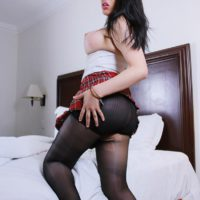 Asian tranny Vivian Black revealing big tits and upskirt cock in pantyhose and skirt