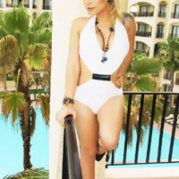 Blonde shemale escort Angeles Cid modeling non nude in high heels outdoors