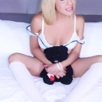 Blonde shemale model Tania Q freeing huge cock for masturbation in knee socks