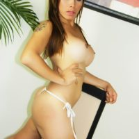 Brunette transsexual Nina Stronghold loosing big tits and shecock from bikini
