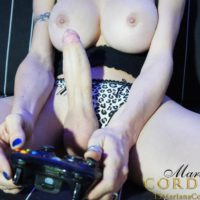 Brunette TS girlfriend Mariana Cordoba having big dick sucked while playing video game