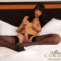 Busty brunette shemale Mariana Cordoba jerking off huge cock in black nylons