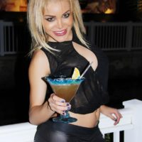 Cute blonde shemale Karla Carrillo posing non nude in leather pants outdoors