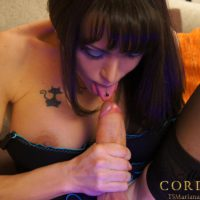 Dark haired TS model Mariana Cordoba licking own cock with pierced tongue in nylons