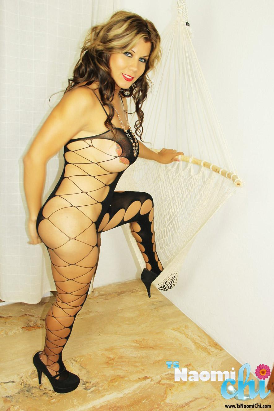 Latina tranny Naomi Chi letting huge tits loose from sexy bodystocking in heels