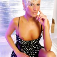 Leggy blonde TS model Blondie Johnson letting firm tits loose from summer dress