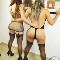 Masked shemale Nina Stronghold and tranny girlfriend share kiss in black nylons