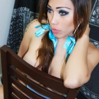 Pretty solo shemale Nina Stronghold flaunting big tits and upskirt cock in pigtails