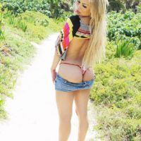Blonde Latina tranny Karla Carrillo showing off big tits in shorts in the woods